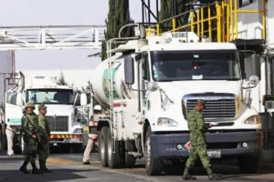 Soldiers check fuel shipments leaving a Pemex storage depot in México state.