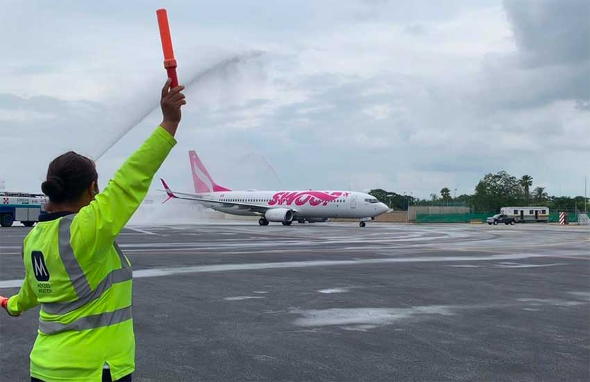 Swoop's inaugural flight to Cancún is baptized on arrival.
