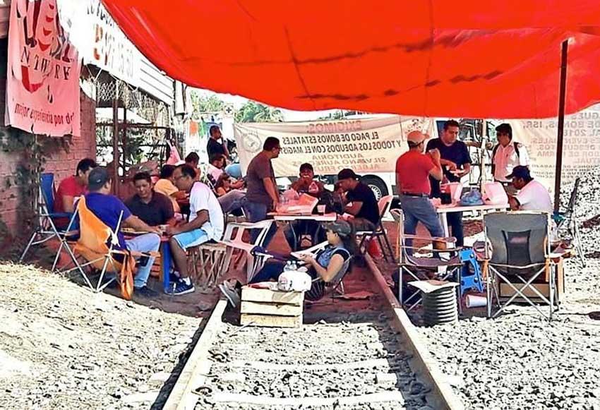 Teachers camp on the railroad tracks in Michoacán.