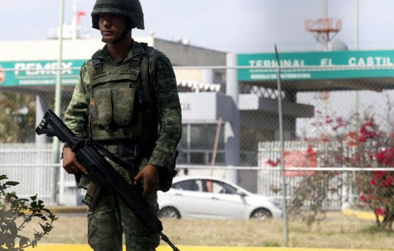 soldier stands guard at pemex