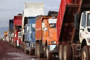 Trucks deliver tezontle to the site of the airport.