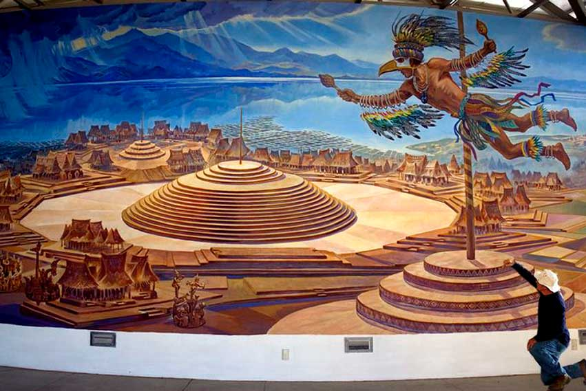 A mural by Jorge Monroy shows the bird man in flight.