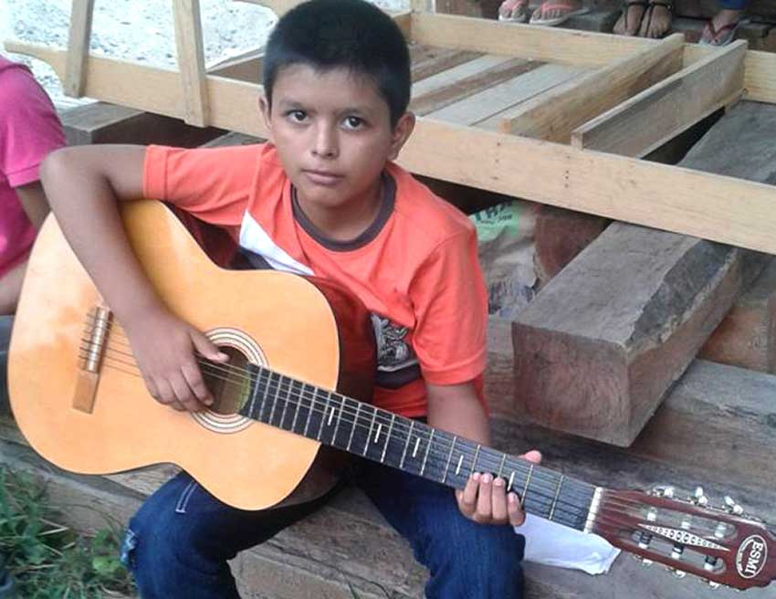 A guitar student at EMAZ.
