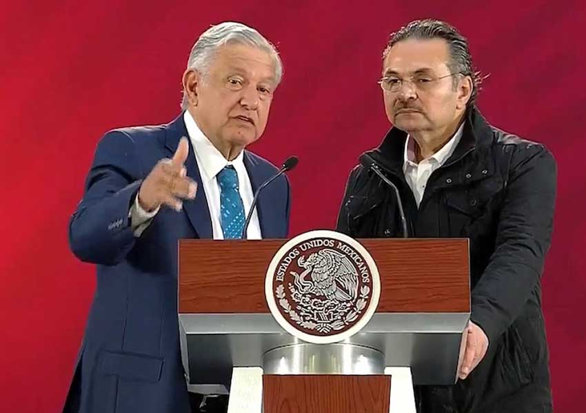 The president, left, and Pemex boss Romero speaking at this morning's press conference.