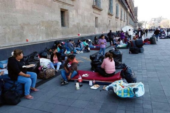 Displaced by violence, citizens from Guerrero camp outside the National Palace.