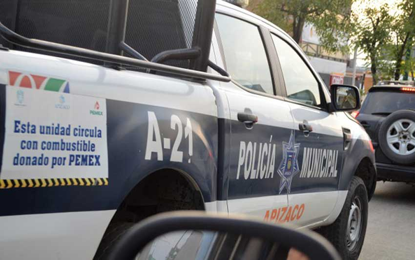 A police vehicle carries a sign indicating its fuel was donated by Pemex. But not all donated fuel went where it was intended.