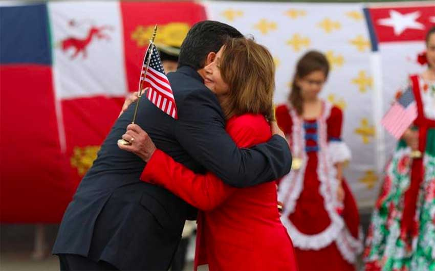 Governor García and Speaker Pelosi hug at the border.