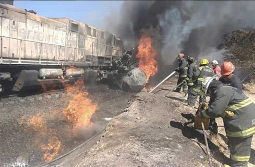 Firefighters at the scene of the tanker truck-train crash.