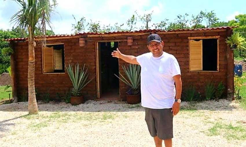 Vázquez and his sargassum house in Quintana Roo.