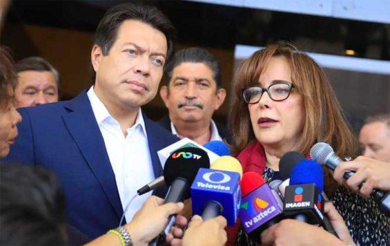 Delgado and Polevnsky speak with reporters yesterday.