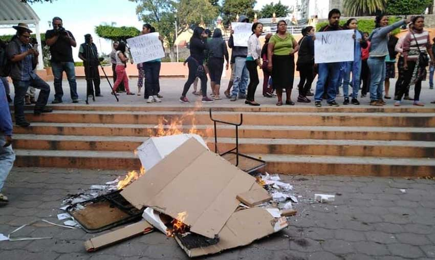 Ballots and documents burn at a polling station in Morelos.