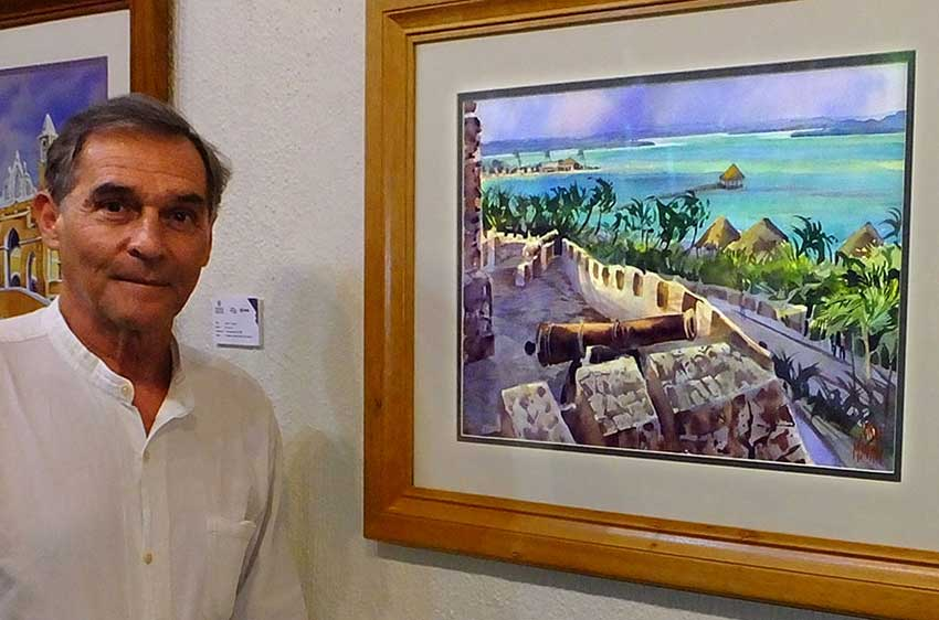 Jorge Monroy with his watercolor, The Lake of Seven Colors at Bacalar.