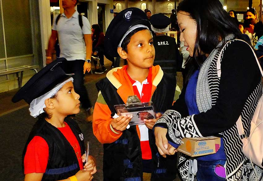 'Just the facts, ma'am,' insist policemen Paolo Ibarra, left, and partner.