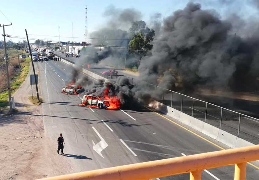 Vehicles burn on a Guanajuato highway.