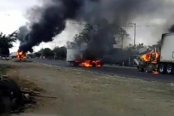 Trucks burn on a Veracruz highway.