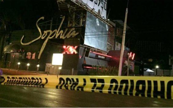 Crime scene tape at the Sophia bar Thursday night in Cuernavaca.