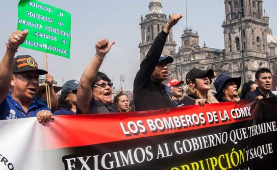 Mexico City firefighters protest earlier this month to demand the resignation of union leader Ismael Figueroa.