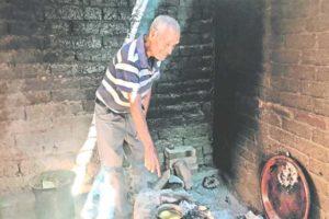 Medina cooks potatoes at his home in Michoacán.