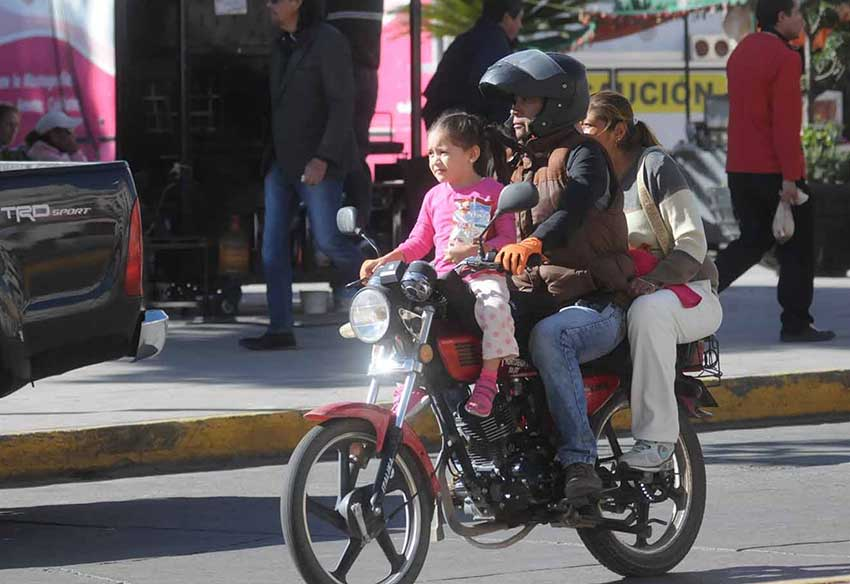 child on motorcycle