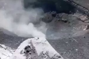 A frame from video footage taken at the volcano El Popo, looking down at the crater.