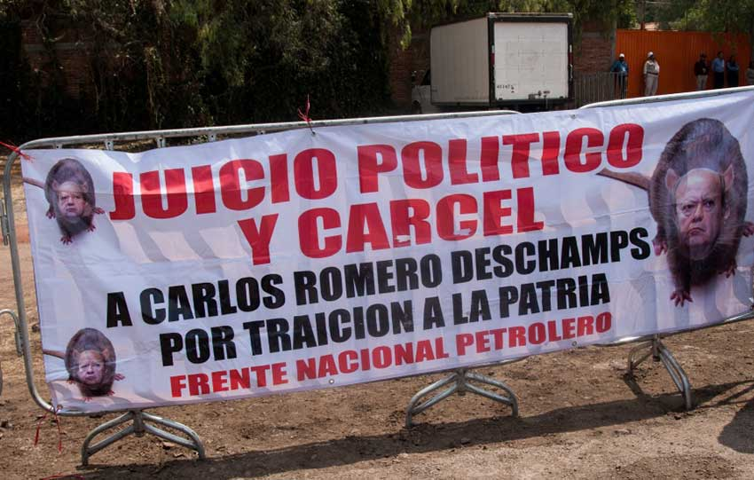 The Pemex union leader was absent from the party but signs demanding he be jailed were not.