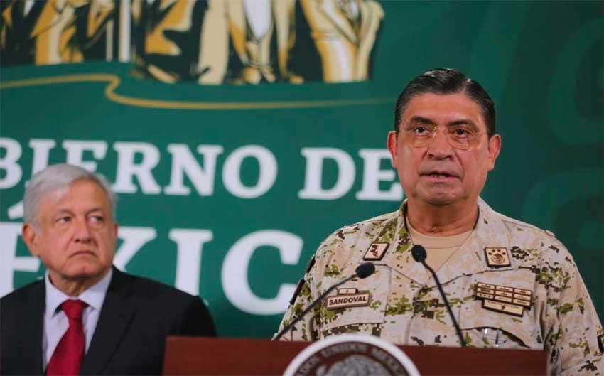 López Obrador listens as Defence Secretary Sandoval discusses advances in Tijuana.