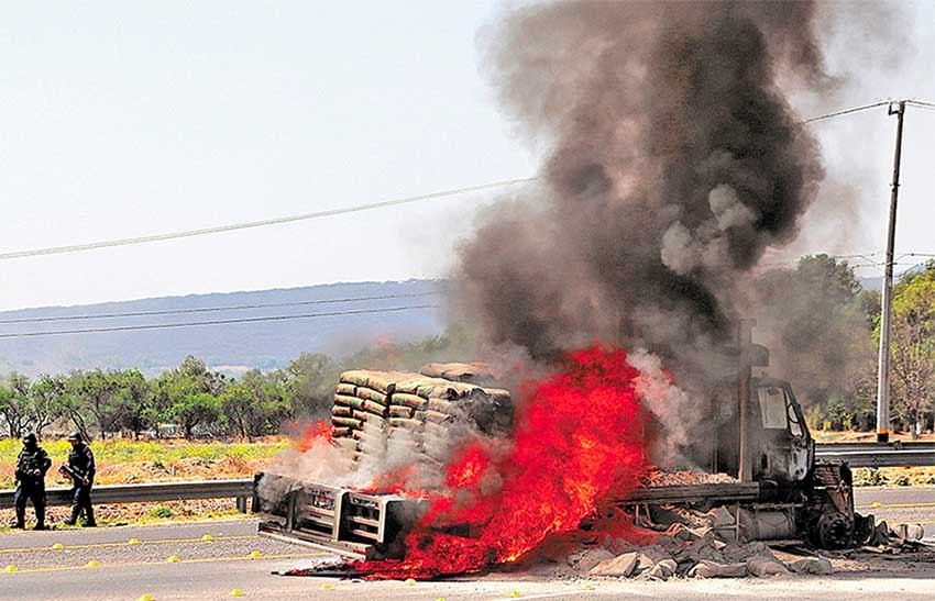 A vehicle burns at a Guanajuato highway blockade yesterday.