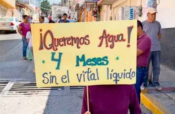 'We want water,' reads the sign of a protester who has not had any for four months.