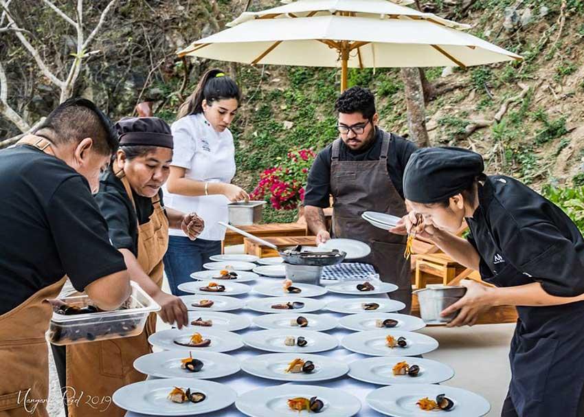 Restaurant crew prepares the plates.