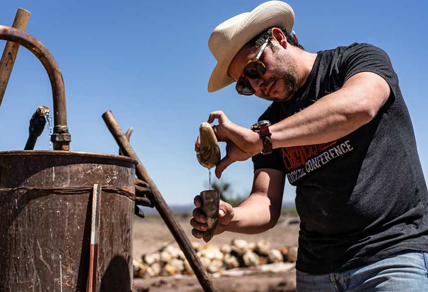 Ricardo Pico uses two horn-shaped vessels to estimate the alcohol content of the sotol he makes at his Chihuahua distillery.