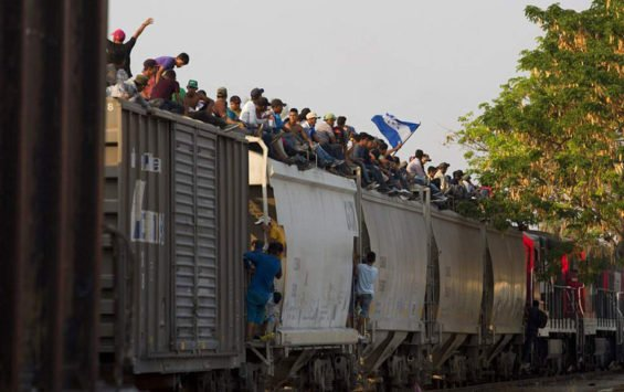 Migrants ride north aboard the freight train called The Beast.