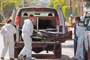 Forensic personnel retrieve bodies in Zapopan.