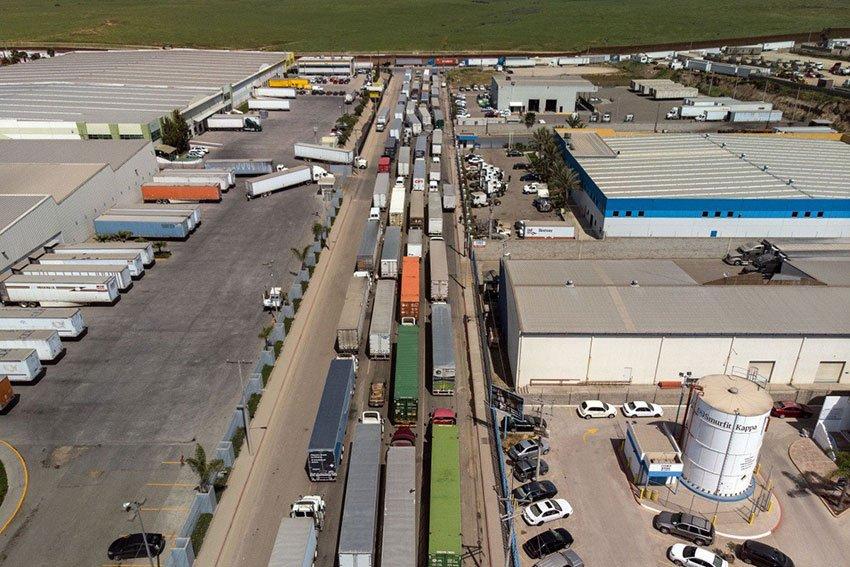 Trucks line up to cross the border at Otay Mesa in Tijuana.