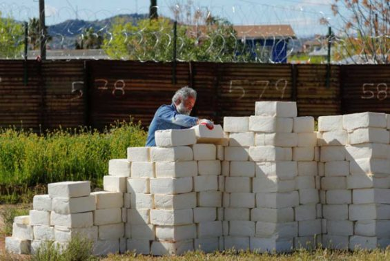 Cavallaro at work on his border wall.