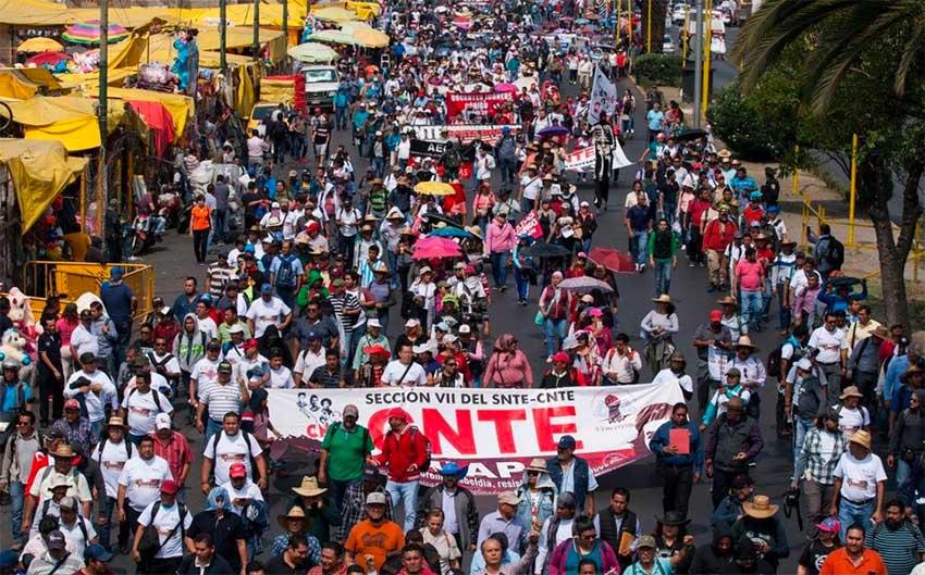 A CNTE protest march, a common sight in Oaxaca.