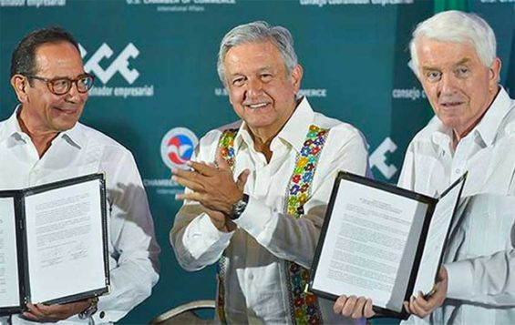 Business leaders Salazar, left, and Donohue, right, flank López Obrador.