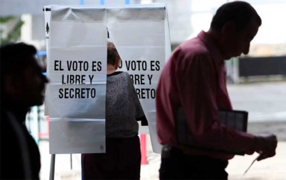 'The vote is free and secret,' the sign reminds voters at a polling station.