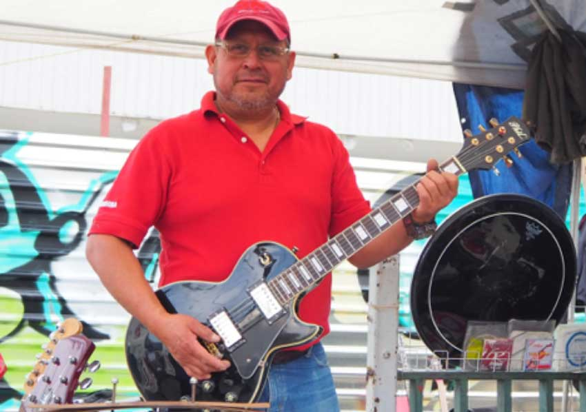 Guillermo Amaya poses with a guitar.