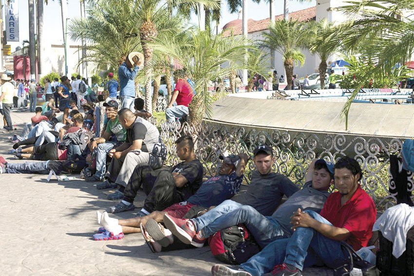Migrants wait to see immigration agents in Mapastepec.