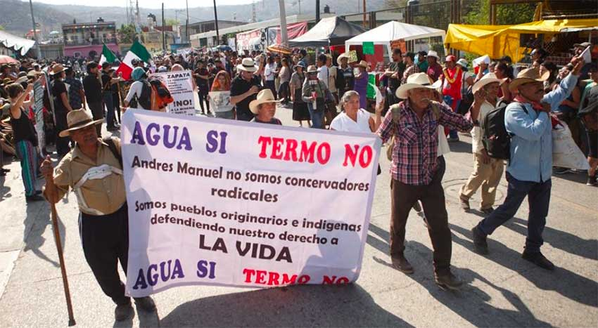 'We are not radical conservatives,' reads the sign addressed to the president, but 'indigenous communities defending our right to life.'