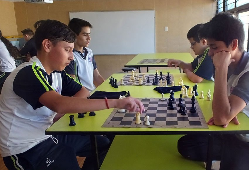Playing chess is part of the program at IMI.