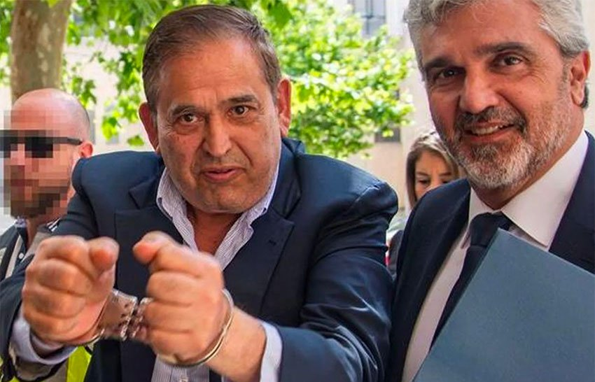 Altos Hornos CEO Ancira shows his handcuffs after his arrest this week in Spain.