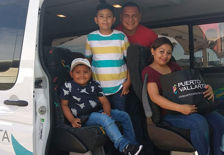 Andrick, left, and his family arrive in Puerto Vallarta on Friday.