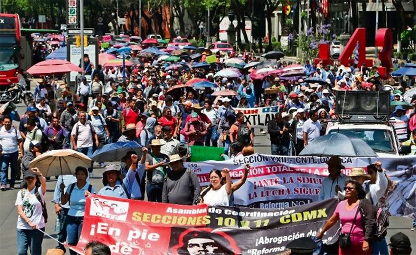 Teachers march in Mexico City yesterday.