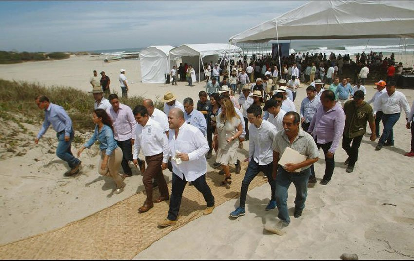 Governor Alfaro leads a tour of the beach during the announcement of a Costalegre development plan.