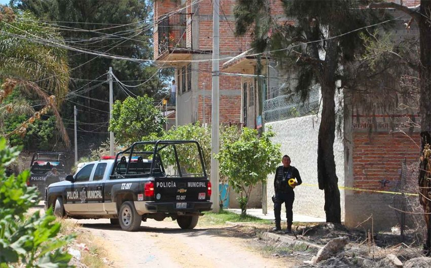 Police at the house in Tlajomulco where kidnapping victims were found.