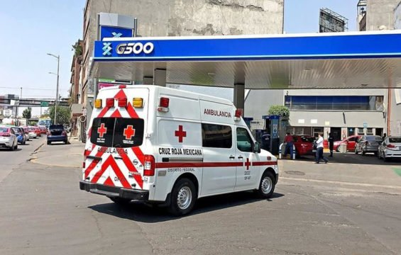 A Red Cross ambulance pulls into the gas station owned by the Red Cross president.