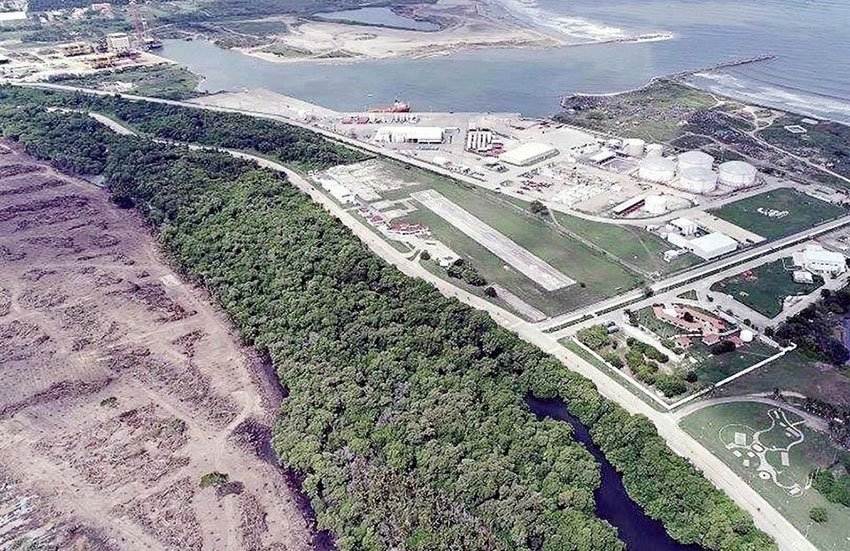 The site of the new refinery is the cleared land to the left.