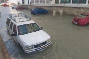 Pacific swell floods a street in Acapulco.