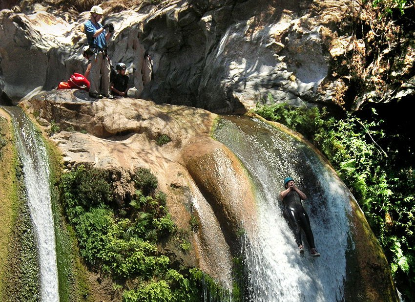 Sliding down a natural water slide in Aquetzalli canyon.